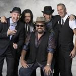 "The Mavericks broke up in 2003 but have returned, hoping to leave ""a bit of a legacy,'' according to leader Raul Malo (center)."